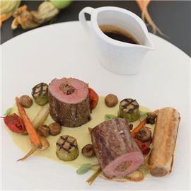 Saddle of lamb filled with southern scents, braised lamb shoulder roll, spring vegetables
