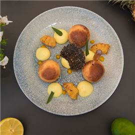 Rum baba with lime zest and vanilla seeds, lime creamy, roast pineapple, thin lace sesame biscuit, pineapple sorbet