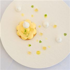 Lemon tart with basil jelly, crisp meringue, ring of white chocolate chip, lime sauce